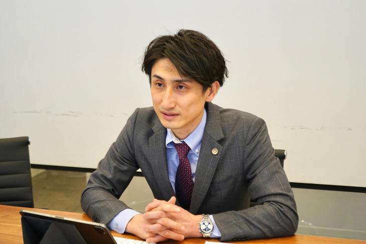 梁田弁護士2