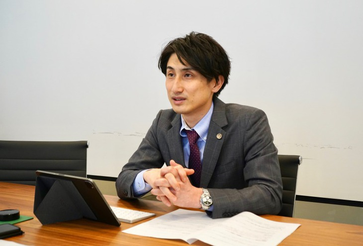 梁田弁護士3
