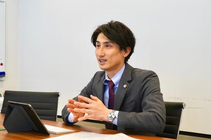 梁田弁護士4